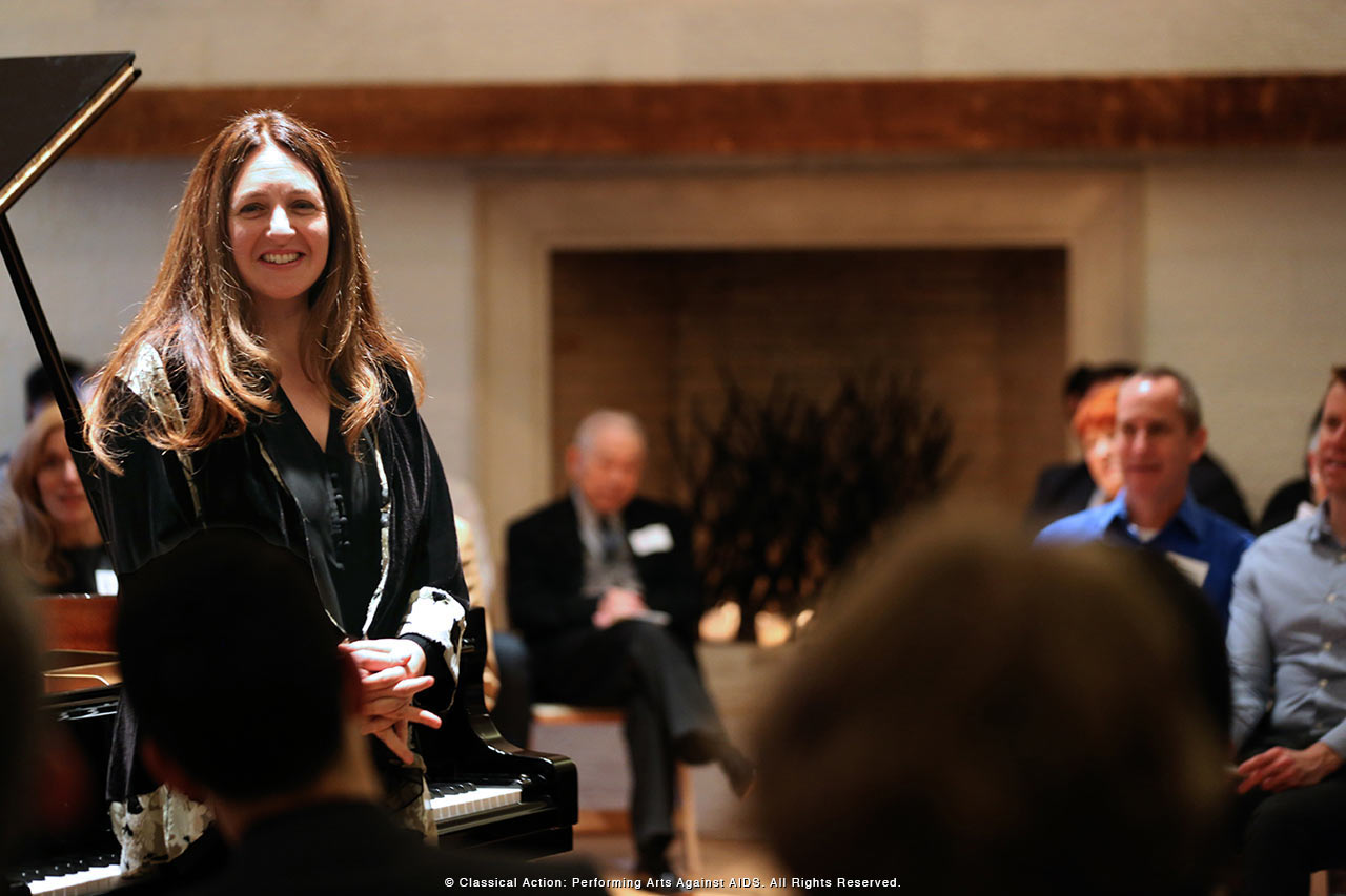 Simone Dinnerstein speaking to the audience - photo by Steve J. Sherman